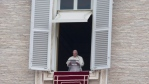 Pope Francis pauses after delivering his message during the Angelus noon prayer in St. Peter's Square at the Vatican, Sunday, July 27, 2014. (AP / Gregorio Borgia)