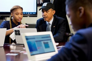 "Adrianna Mitchell, a middle-school student from Newark, NJ, explains a coding learning program to President Barack Obama during an ""Hour of Code"" event in the Eisenhower Executive Office Building on the White House complex in Washington, DC, on Monday, Dec. 8, 2014.  (Jacquelyn Martin/AP)"